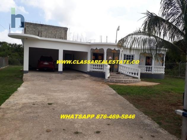 Photo #1 of 16 - Property For Sale at FLAMINGO BEACH, Greenwood, St. James, Jamaica. House with 2 bedrooms and 2 bathrooms at JMD $28,000,000. #405.